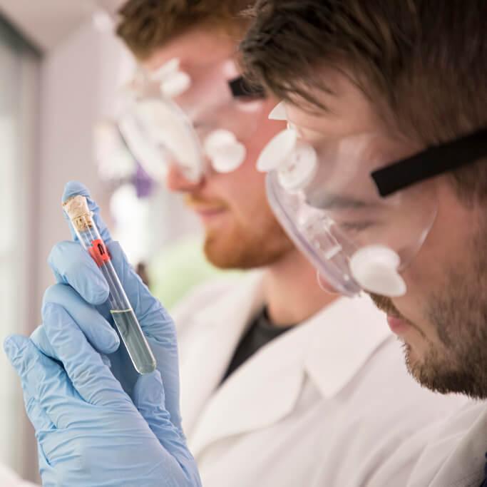 Photo of students conducting work in professor Bogdan Wilk's organic chemistry class.