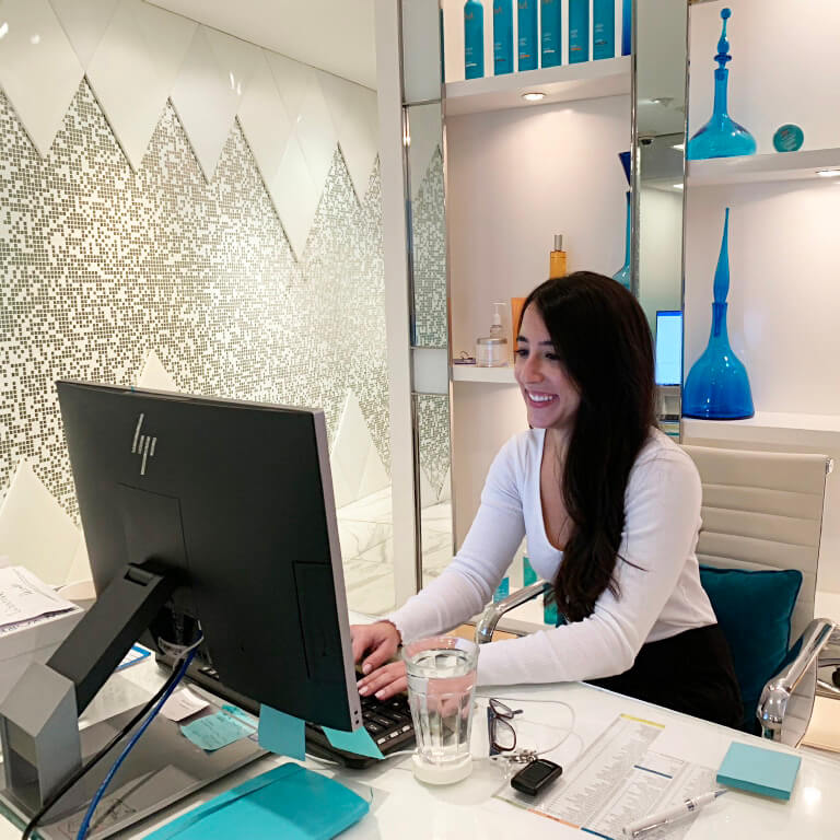 Photo of Ariana Murdocca, GR Communication student, at her internship at Moroccanoil in NYC.